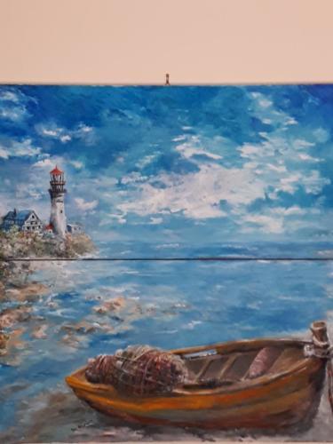 Il faro e la barca